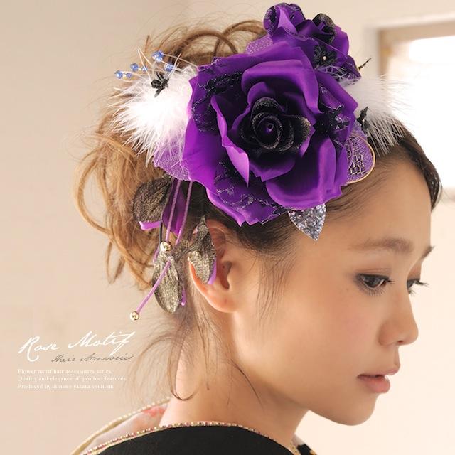 大きな紫系のバラ髪飾り